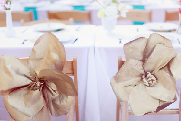 Giant-Gold-Paper-Flowers-on-Reception-Chairs-600x400